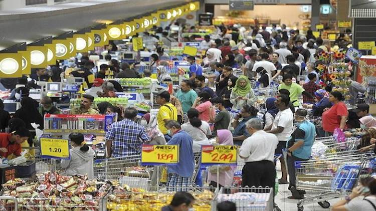 People Stock Up On Essentials As Lockdown Fear Tak